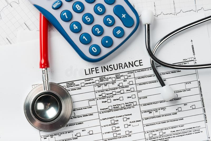 Life insurance application form with banknote and stethoscope. Concept for life planning stock images