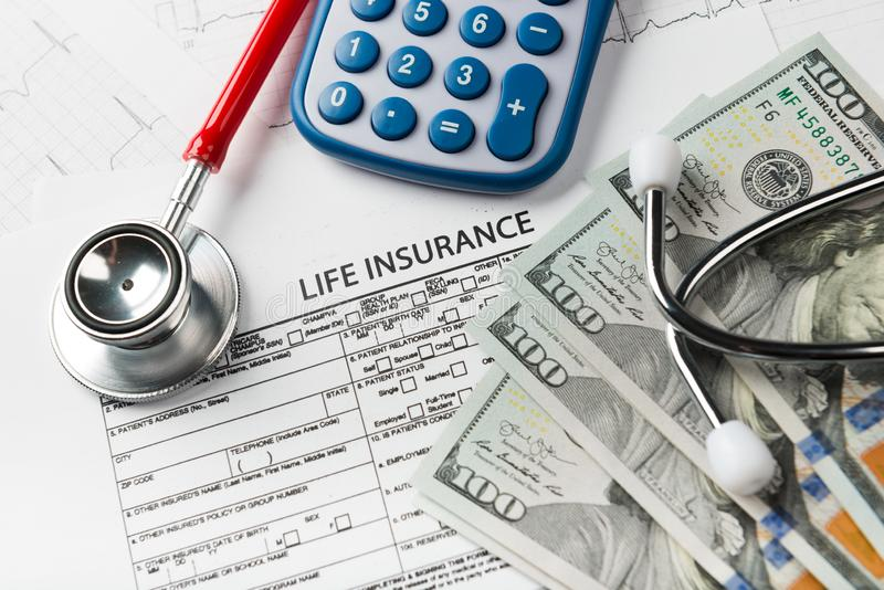 Life insurance application form with banknote and stethoscope. Concept for life planning royalty free stock photo