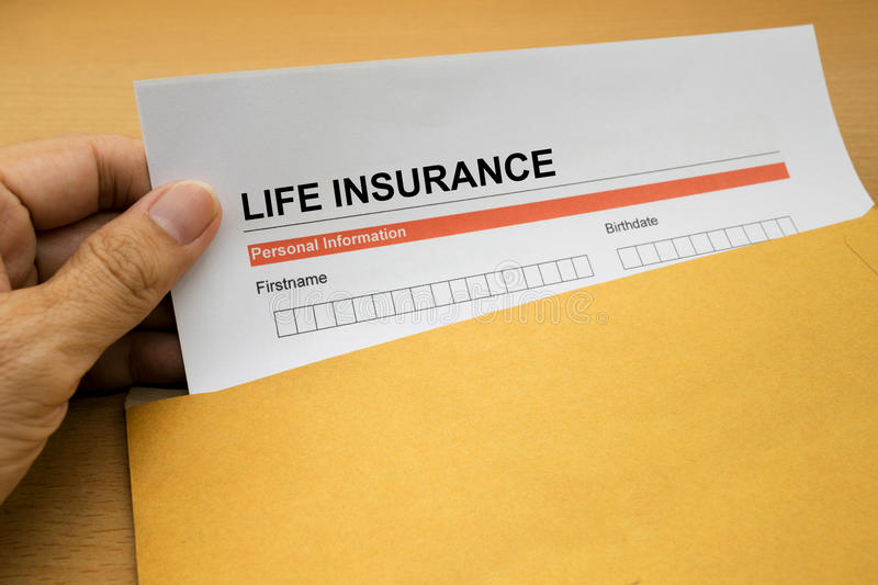 Life Insurance application form. On brown envelope stock photography
