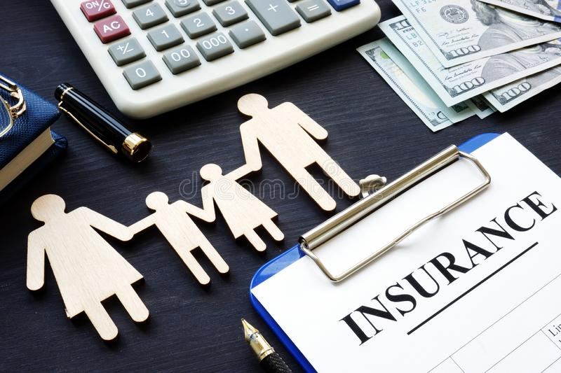Life insurance. Policy and figures of family. stock images