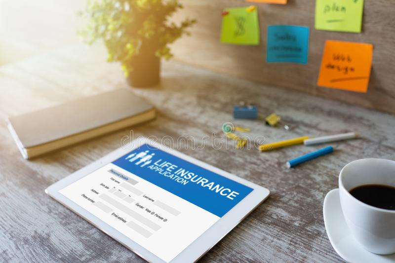 Life insurance online application form on device screen. stock images