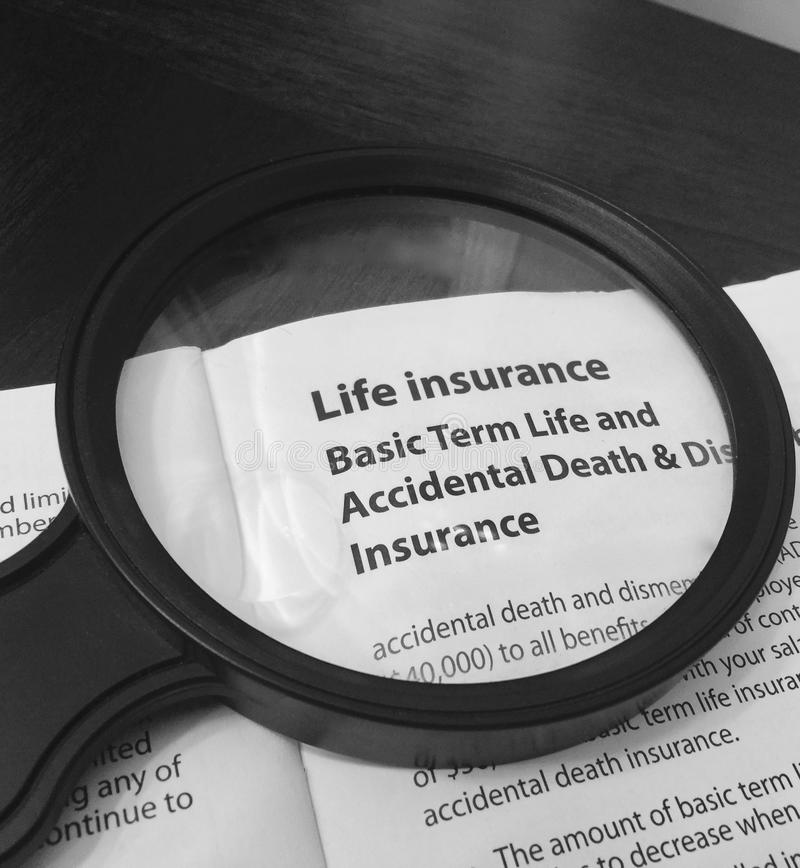 Life Insurance Policy Breakdown in Black and White. A document breaks down the coverages and cost of a Basic Term Life and Accidental Death Insurance policy in stock image
