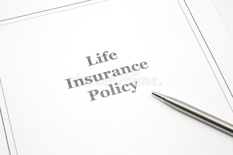 Life Insurance Policy with a pen to sign. A life insurance policy with a pen to sign royalty free stock photo