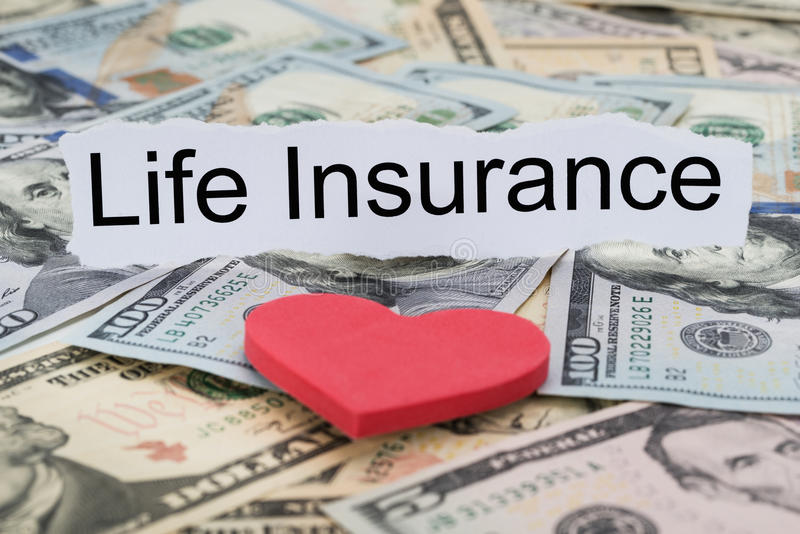Life insurance text on piece of paper. Close-up Of Car Insurance Text On Piece Of Paper With Banknotes And Heart royalty free stock photo