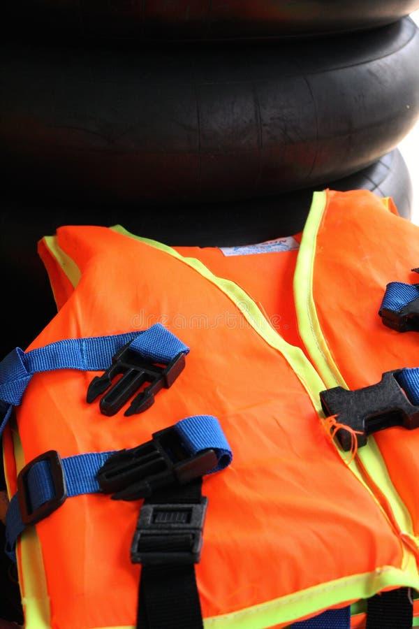 Life jacket. Orange life jacket in the beach royalty free stock image