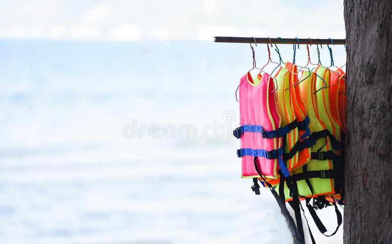 Life jacket safety equipment hang clothes line in the sea background stock photos
