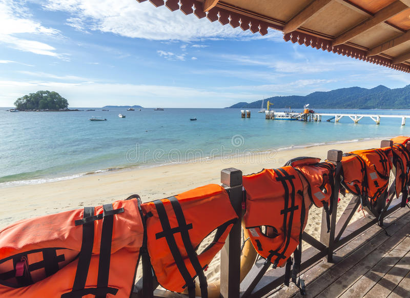 Life jackets. At the balcony with beach background stock photography