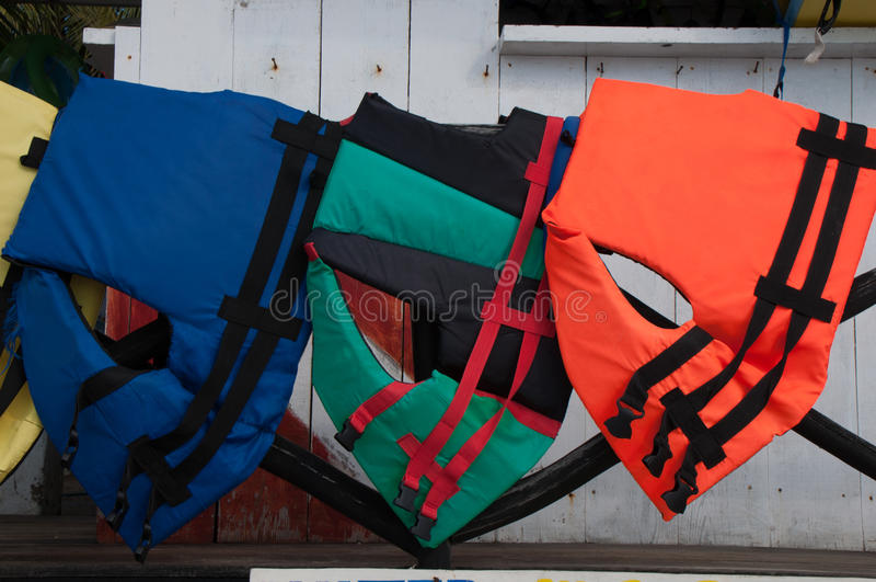 Life Jackets in Zihuatanejo. This is an image of three colorful life Jackets on a rack in Zihuatanejo, Mexico, a fishing village near Ixtapa stock image