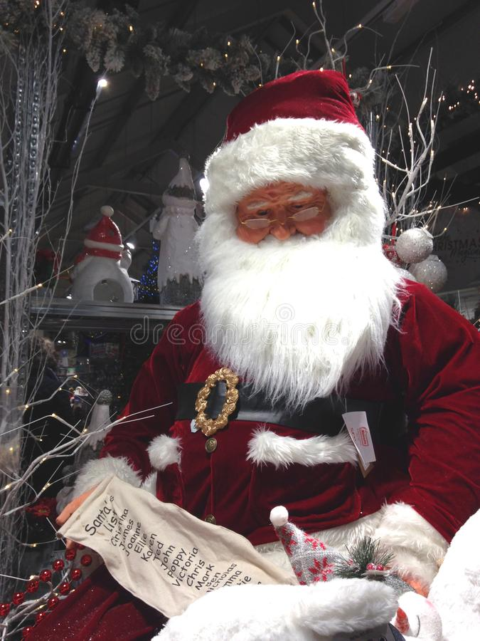 Santa Claus with his Christmas list of names stock images