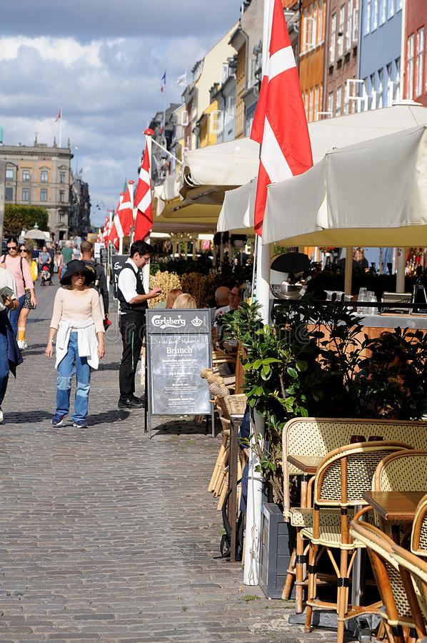 LIFE ON NYHAVN CANAL IN COPENHAGEN DENMARK stock images