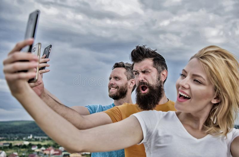 Life online. People taking selfie or streaming online video. Mobile internet and social networks. Mobile dependency. Problem. Girl and men with mobile royalty free stock photography