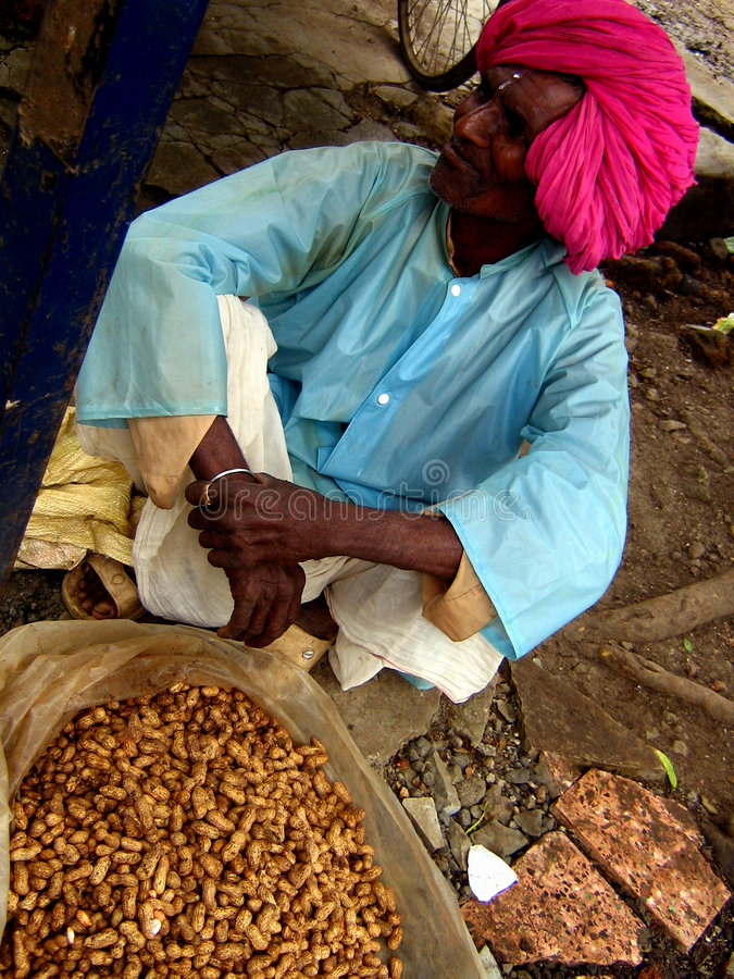 Life is Peanuts. Life is lived at peanuts price for this poor Indian peanut selling old man stock images