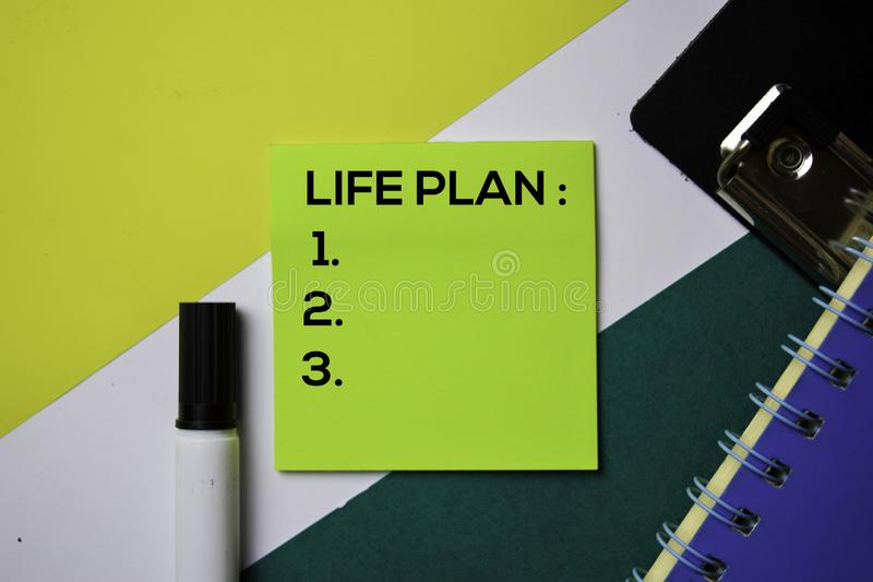 Life Plan support by adding number text on sticky notes with office desk concept stock photo