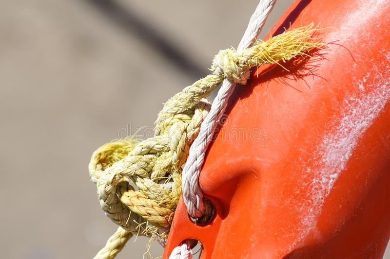 Life ring on the beach and sea knots. Close up. Life ring on the beach and sea knots. Close up stock image