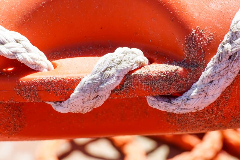 Life ring on the beach and sea knots. Close up. Life ring on the beach and sea knots. Close up stock photos