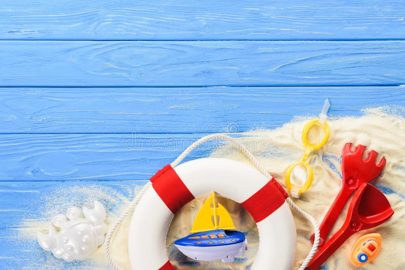 Life ring and toy boats on blue royalty free stock image