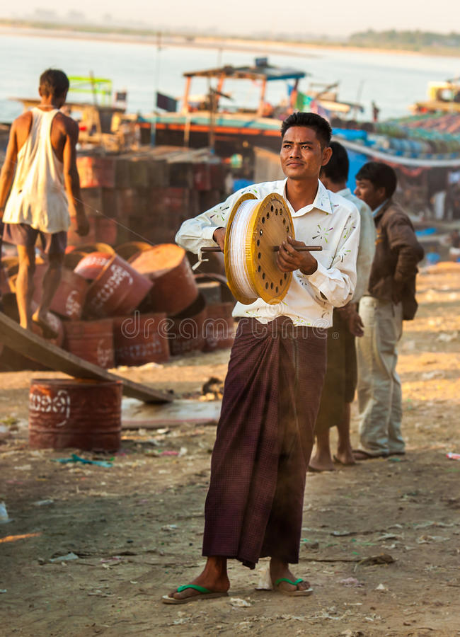 Life on a river. Mandalay - December 2: Life on a river on the outskirts of Mandalay Deсsember 2, 2013 in Mandalay. People living in shacks on the banks royalty free stock image