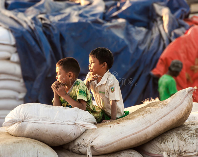 Life on a river on the outskirts of Mandalay. Mandalay - December 2: Life on a river on the outskirts of Mandalay Deсsember 2, 2013 in Mandalay. People living stock photography