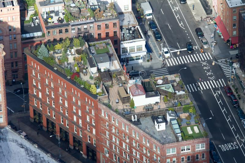 Life on the roof in New York City. Life on the roof of a building in New York City. The view form the One World Trade Center stock image
