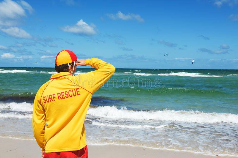 Life saver. Young man life saver watching the situation on the sea royalty free stock photography
