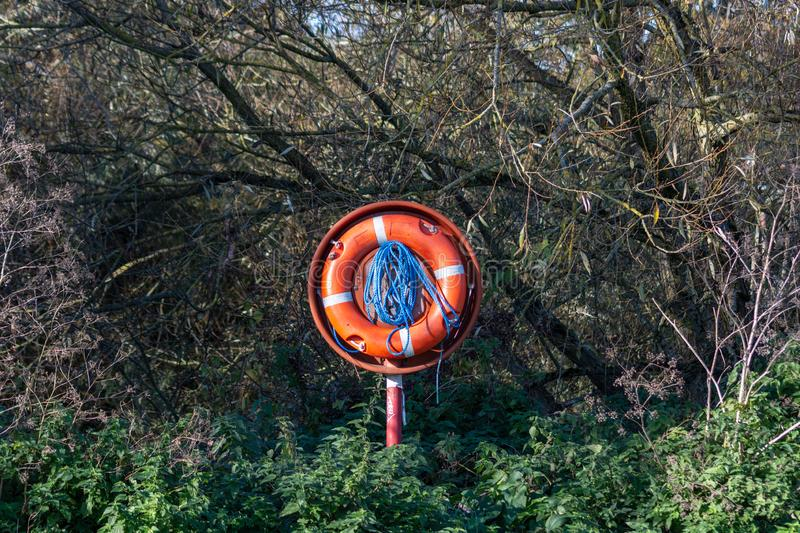 Life saver or life buoy with rope beside a river stock photos