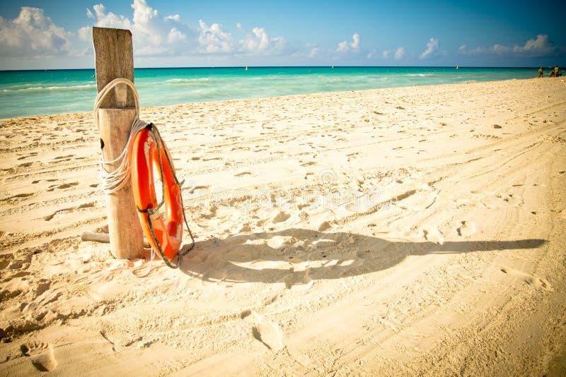 Life saver on idillic beach. stock photos