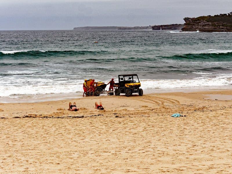 Bondi Beach Life Savers on an Overcast Summer Morning, Sydney, Australia. Life savers or guards, surf rescue, at the yellow sand Bondi Beach, Sydney, NSW royalty free stock photography