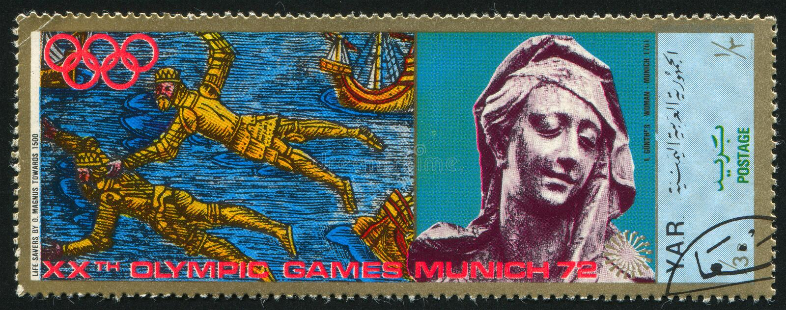 Life savers by Magnus and a Statue. YEMEN - CIRCA 1972: stamp printed by Yemen, shows Life savers by Magnus and a Statue, circa 1972 royalty free stock photos