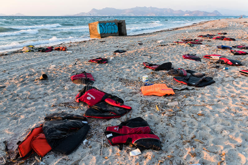Life savers of refugees in Greece. Abandoned life savers of refugees on October 6, 2015 on a beach of Kos island, Greece. Thousands of Syrian refugees have stock photo