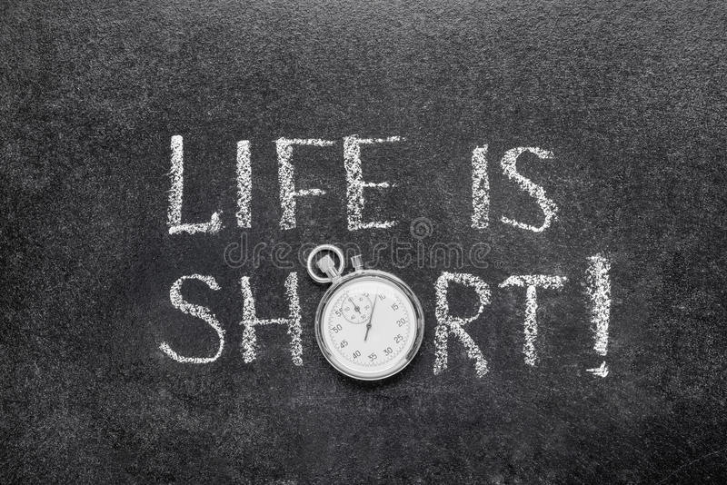Life is short watch. Life is short exclamation handwritten on chalkboard with vintage precise stopwatch used instead of O royalty free stock photos