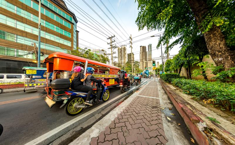 Daily life on the streets of Manila. MANILA, PHILIPPINES - CIRCA MARCH 2018: View on daily life on the streets of the city as cars and pedestrians pass by during stock images