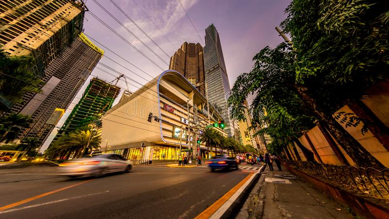 Daily life on the streets of Manila. MANILA, PHILIPPINES - CIRCA MARCH 2018: View on daily life on the streets of the city as cars and pedestrians pass by during royalty free stock photo
