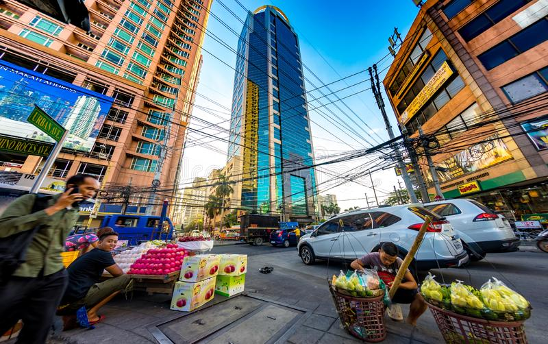 Daily life on the streets of Manila. MANILA, PHILIPPINES - CIRCA MARCH 2018: View on daily life on the streets of the city as cars and pedestrians pass by during stock image