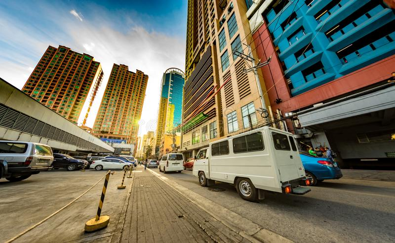 Daily life on the streets of Manila. MANILA, PHILIPPINES - CIRCA MARCH 2018: View on daily life on the streets of the city as cars and pedestrians pass by during royalty free stock photos