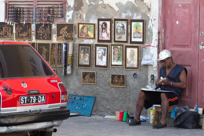 Life on the streets of Mindelo. Artist stock images