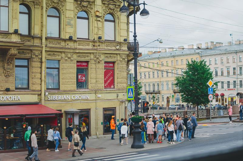 Daily life on the streets of St. Petersburg. Pedestrians walk along the sidewalk. stock image