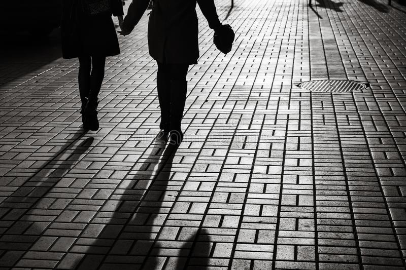 Silhouettes of people walking the streets of a big city royalty free stock images