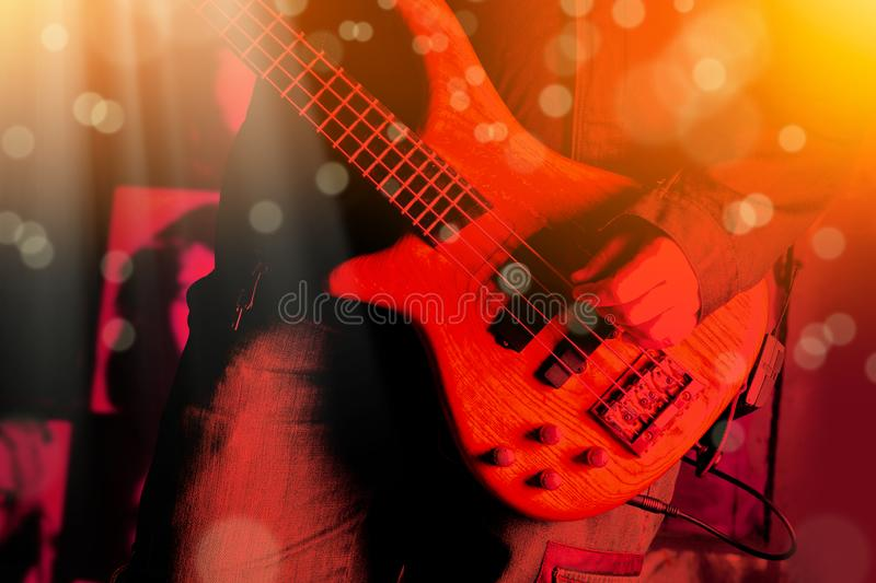 Life style image of close up young man hand, playing electric ba royalty free stock image