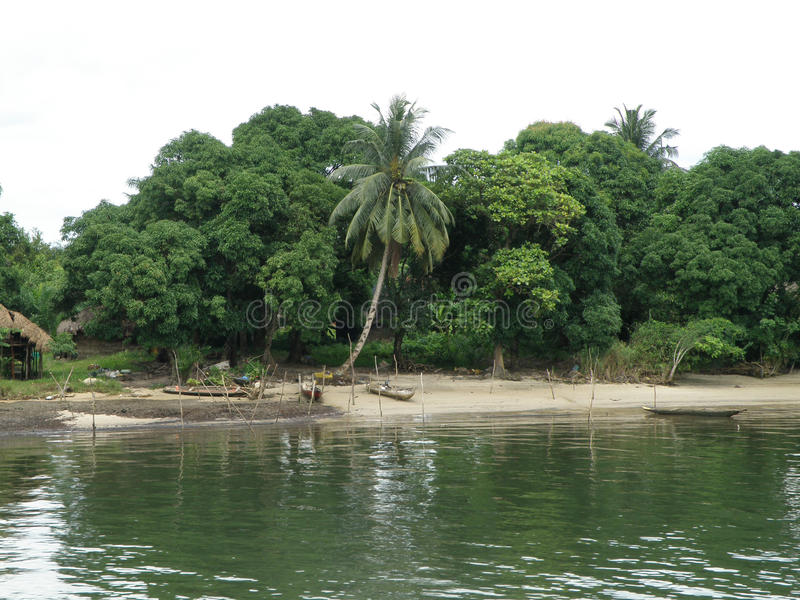 Life in the Tropics. The huts of local residents along the river bank in Warri, Nigeria in tropical Africa stock photography