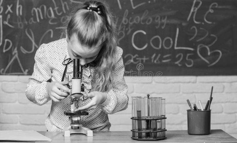 Life under microscope. science experiments in bilogy lab. Little scientist work with microscope. Chemistry research royalty free stock image