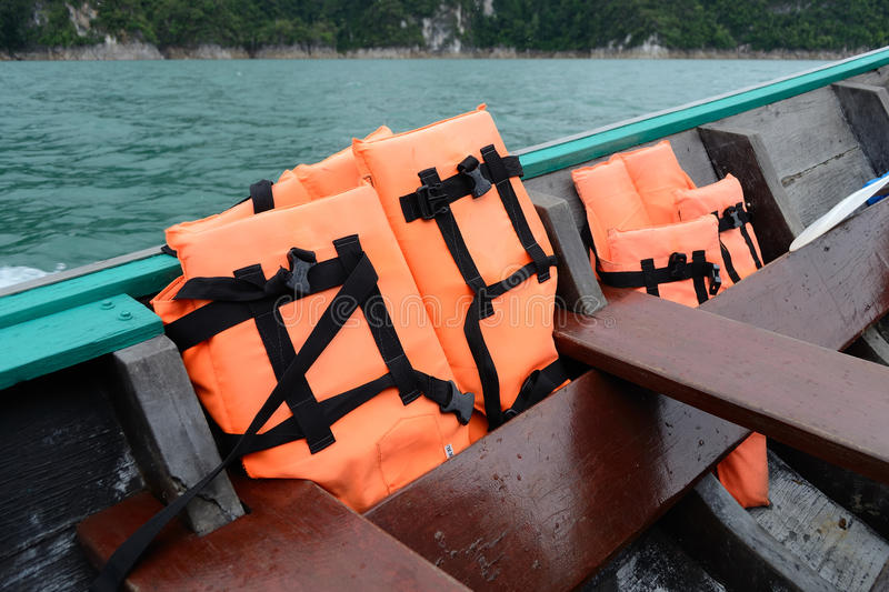 Life vest. Orange life vest in the long tail boat stock photography