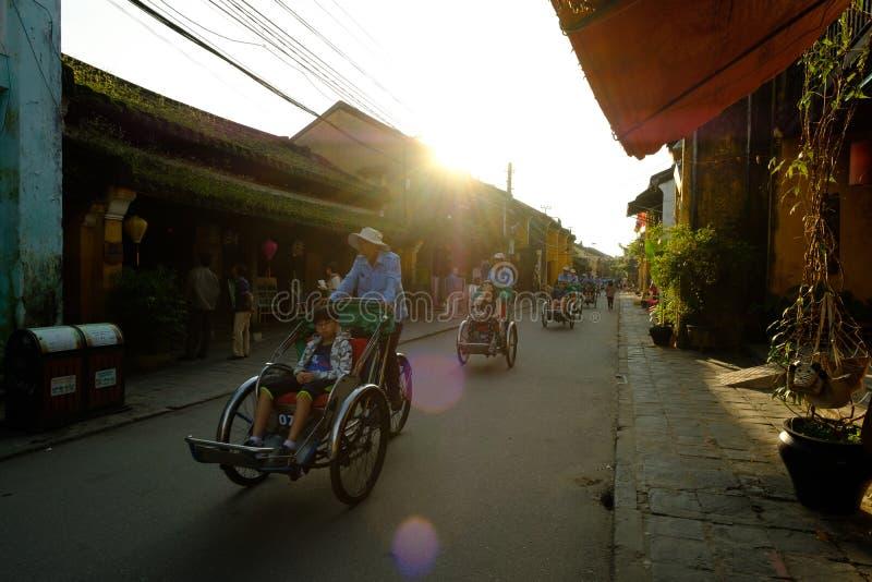 Life in vietnam- Cyclo beside Sword lake in hanoi, vietnam. Cycl royalty free stock image