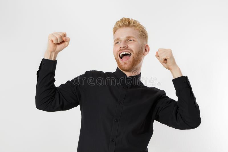 Life winner and Successful young entrepreneur. Redheaded guy with red beard isolated. Black shirt stylish male. Scandinavian royalty free stock images