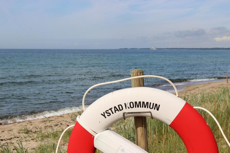 "Lifebelt in front of the Baltic Sea. On the shore of Ystad, South Sweden, Scandinavia, Europe. Ystad is film location for the crime series ""Wallander royalty free stock photo"