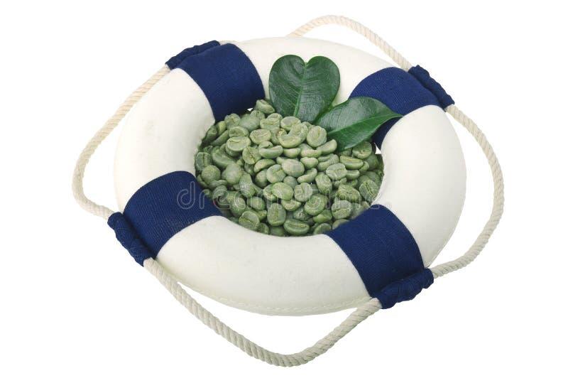 Lifebelt met groene koffiebonen stock fotografie
