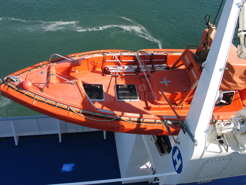 Lifeboat in bright orange. Lifeboat rescue boat on a big passenger ferry boat stock photos