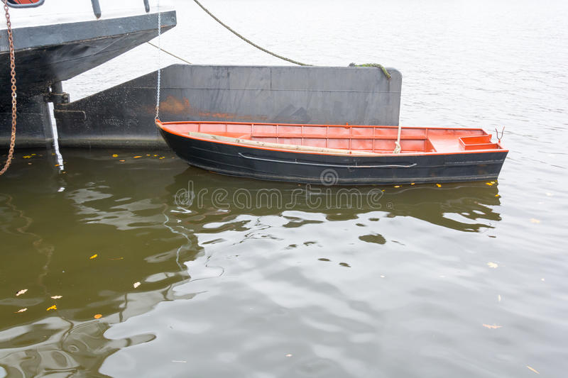 Lifeboat tied for cargo ships at the rudder royalty free stock images