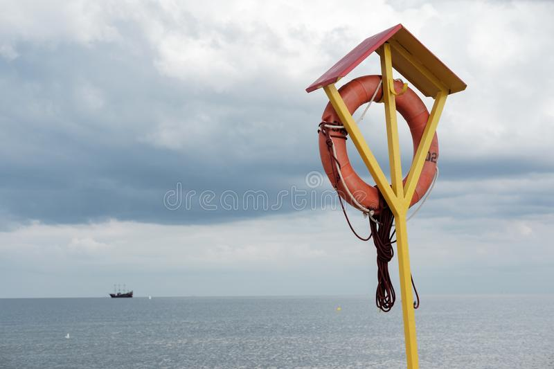 Lifebuoy on the beach royalty free stock photos