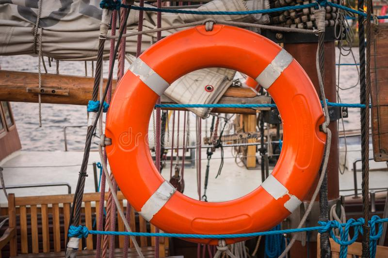 Lifebuoy carried by ship. Orange lifebuoy carried by the old ship royalty free stock photos