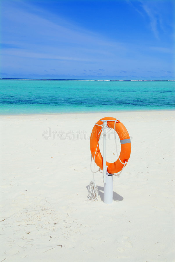 Lifebuoy e praia foto de stock royalty free